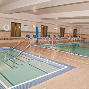 indoor pool & hot tub with a lift enjoy the calming waters at Dickinson