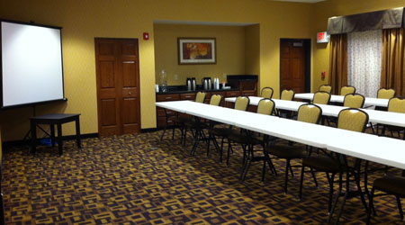 Dickinson, ND classroom style meeting room with long tables & a projection screen