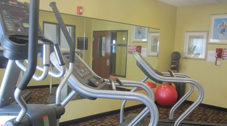 Glendive fitness center with a wall of mirrors and a red medicine ball