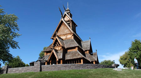 Scandinavian Heritage Park in Minot shows log cabins and Danish windmill